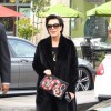 MomAGer Slay: Kris Jenner Spotted Out Rockin'  Red Timberland Boots x All Black Fur x GUCCI Snake Print Leather Pouch